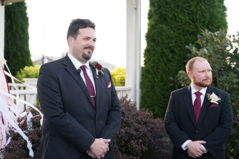 A groom sees his bride for the first time during their ceremony at Hermitage Hill Farm in Waynesboro, Virginia.