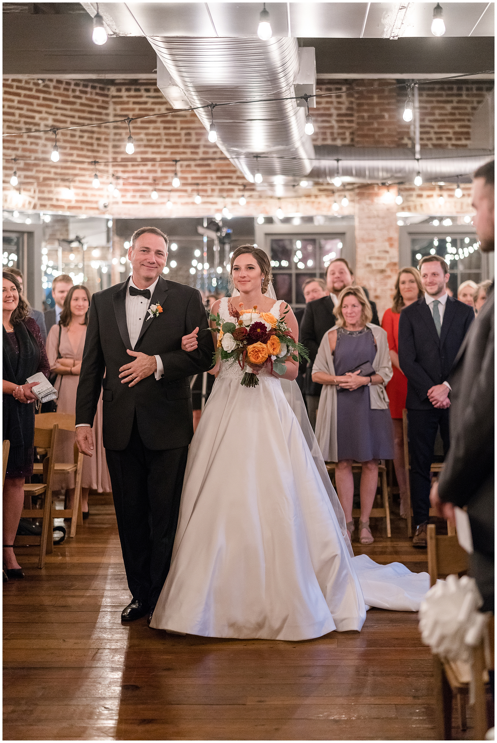 A father walks his daughter down the aisle at Toolbox DC during a Washington DC wedding.