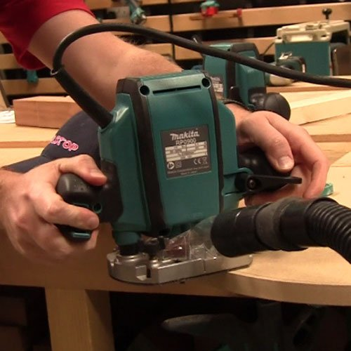The Makita 1/4-inch/ 3/8-inch Plunge Router is an entry-level plunge router that works like most other established models. We mostly loved the compact and lightweight design of this router accompanied by 900W motor which operates at 27,000rpm.