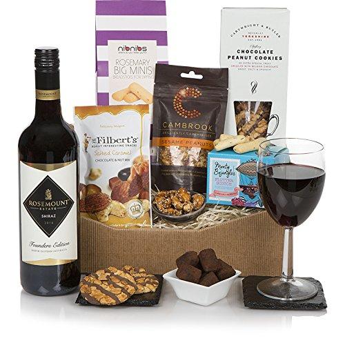 La cesta selecta de comida gourmet: una cesta de regalo con queso y vino adecuada para él o para ella