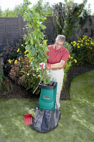 Will shred most hedge trimming and even woody growth that is not to thick