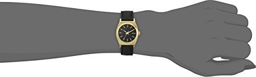 21YbgPYeUsL Sleek watch featuring gold-tone tonneau-shape case and logoed dial with stick markers 26 mm stainless steel case with mineral dial window Japanese quartz movement with analog display