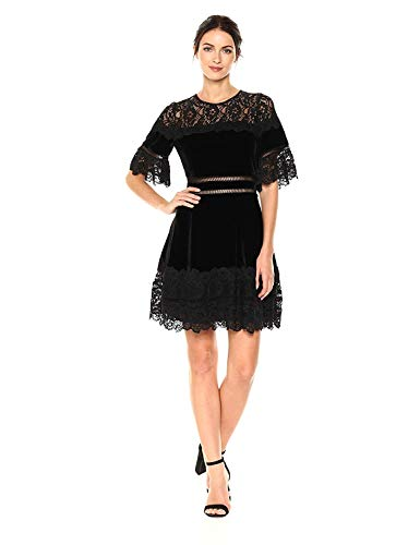"""61y9Qja7CVL The celebration dress, epitomized: Lush velvet and noirish lace combine to dramatic effect in this striking silhouette. Ladder stitching at the waist and cascading lace lend femme dimension while revealing glimpses of skin beneath. Hits at mid thigh. 36 1/2"""" inches from model high point shoulder."""