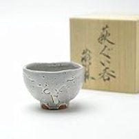 Hagi yaki Japanese ceramic. White guinomi sake cup with wooden box made by Takao Tahara.