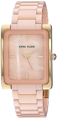 41CkuiWJFEL Curved dome mineral crystal lens; peach mother-of-pearl dial with gold-tone hands and markers Peach colored ceramic adjustable link bracelet; jewelry clasp and extender Japanese-quartz Movement