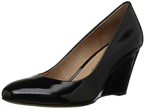 71foSE9dplL This closed-toe pump in leather stands tall atop a tapered wedge heel Padded insole