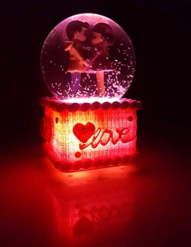 couple in glass ball gift