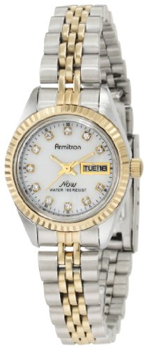 41hQPoyM53L 11 Swarovski® crystal markers Mother-of-pearl dial with a day and date calendar feature at three o'clock Two-tone stainless steel case and bracelet with a coin edge bezel and a fold over buckle