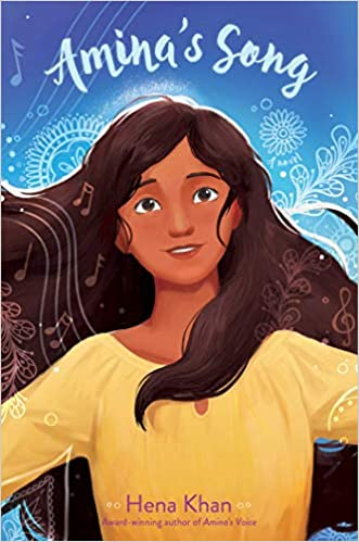 The book cover shows a Pakistani teen girl wearing a yellow top with her dark hair flowing freely. She has tan skin and dark eyes and she's on a blue background with white mofits such as elaborate circles and floral designs on the top of the book cover in white it says Amina's Song.