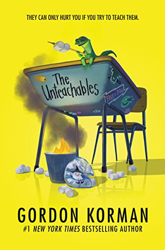 Book cover of The Unteachables by Gordon Korman featuring a cartoon image of a middle school desk and a trash can on fire