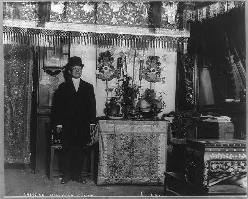 Photo: Chinatown, NYC, Chinese New Year Feast, February 2, 1916, Chinese man, food on table . Size: