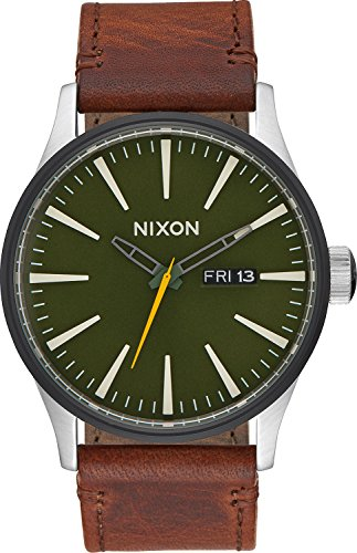 51QE7pAS6eL A timeless 42mm design with the modern Nixon twist of faceted applied hour indices 3-hand movement, day/date window at 3 o'clock and printed seconds track Primary Material: Leather Calfskin