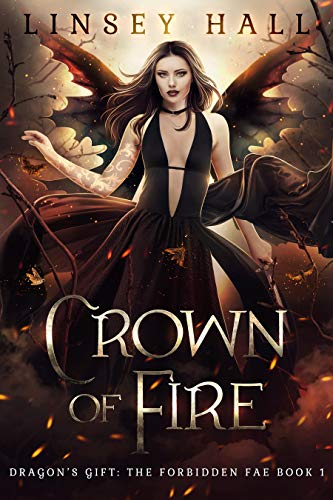 book cover demon woman with tattoos and black wings surrounded by flames crown of fire