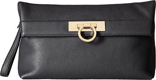 "Calfskin leather body . Gold tone hardware . Single wristlet strap . Gancio lift lock closure . 1 zipper compartment . Engraved designer lettering Fabric lining . 1 slip pocket . Designer plaque Length 11.4""; Height 7.1""; Width 3.1""; Wristlet Strap Drop 5.9"""