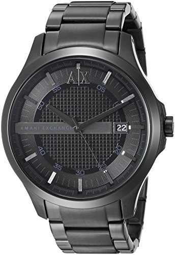 51hoYL%2Bfo5L Solid black watch featuring grid-textured center dial, ribbed hour track, and applied logo at 12 o'clock 46 mm stainless steel case with mineral dial window Quartz movement with analog display