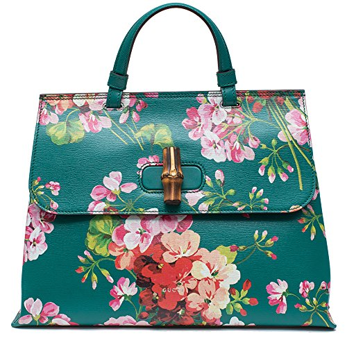 61OXWmQ5qXL Made in Italy. Gucci Bamboo Daily Top Handle Bag Blooms Print Leather Medium presented in the brand's Cruise 2016 Collection by head designer Alessandro Michele reinterprets the brand's classic design with a modern, fresh 70s flair. Matching continental wallet sold separately. ($799) Crafted from green textured leather, this iconic, fashion-forward tote features multicolor feminine blooms prints, a single looped leather handle, front flap with bamboo twist-lock closure, side magnetic side snaps and aged silver-tone hardware accents. Its interior showcases a roomy beige fabric-lined interior with side zip and slip pockets storing daily essentials. Its detachable leather strap allows this bag to be worn longer on the body. A beautiful, romantic tote made for the new Gucci girl