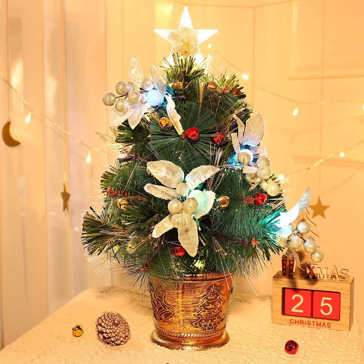 Amazon Com Unomor Tabletop Christmas Tree With Led Star Treetop Mini Artificial Christmas Tree With Fiber Optic Lights And Silver Berries For Christmas Decorations 20 Inch Christmas Bells Not Include Home