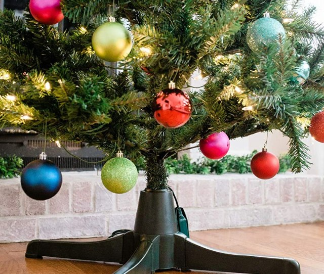 Amazon Com Winter Wonder Rotating Christmas Tree Stand For Artificial Trees Home Kitchen