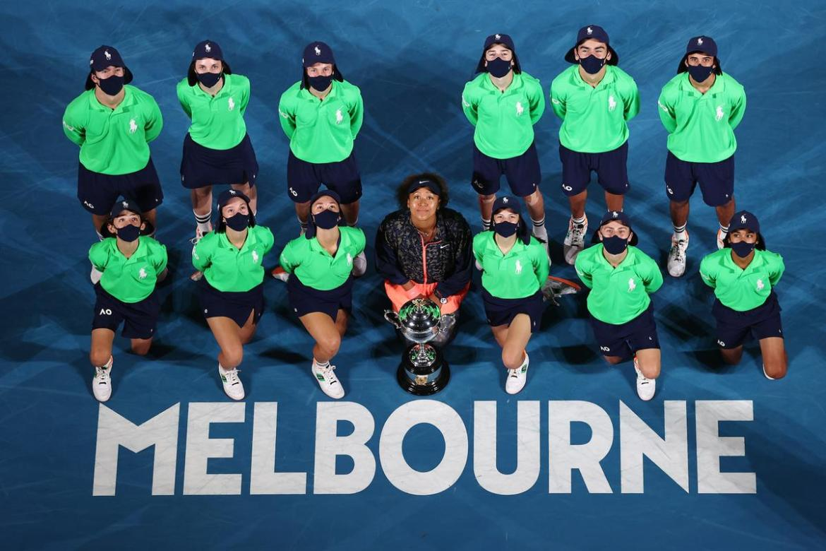Naomi Osaka poses with the ball kids after her Australian Open victory.