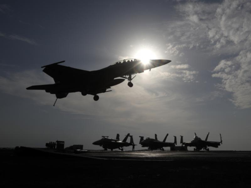 A US fighter jet lands on the deck of an aircraft carrier (file image)