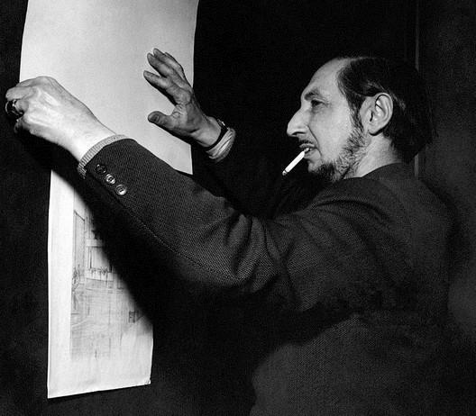 Carlo Scarpa studying drawings by Frank Lloyd Wright in 1954. Image © Mario De Biasi (public domain)