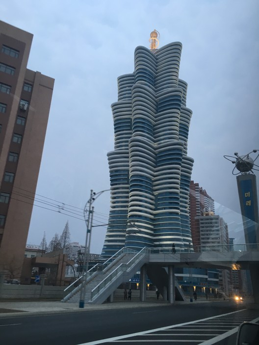 A recent residential tower block, containing apartments for scientists and teachers. Image © Koryo Tours courtesy of Alex Davidson