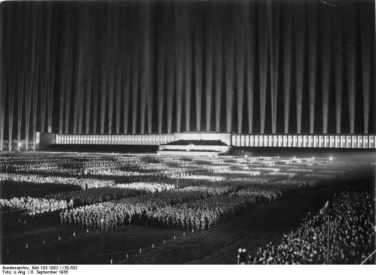 Zeppelinfeld Stadium, Albert Speer. Image Courtesy of Bundesarchiv, Bild 183-1982-1130-502 <a href='https://commons.wikimedia.org/wiki/File:Bundesarchiv_Bild_183-1982-1130-502,_N%C3%BCrnberg,_Reichsparteitag,_Lichtdom.jpg'>via Wikimedia</a> licensed under <a href='http://https://creativecommons.org/licenses/by-sa/3.0/de/deed.en'>CC BY-SA 3.0 DE</a>