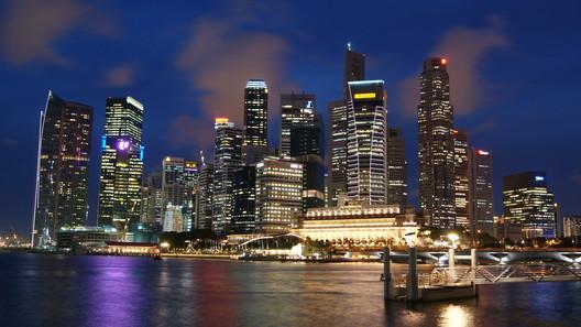 Singapore skyline at night. Image <a href='https://commons.wikimedia.org/wiki/File:Singapore_Skyline_at_Night_with_Blue_Sky.JPG'>via Wikimedia</a> (public domain image taken by Wikimedia user Merlion444)