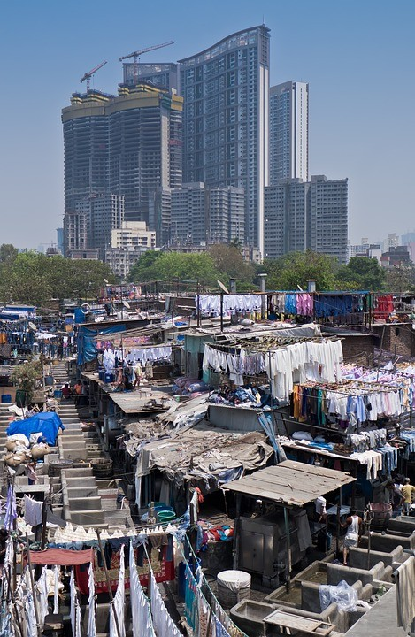 Social Inequity in Mumbai. Image <a href='http://maxpixel.freegreatpicture.com/Laundry-India-City-Mumbai-Building-Slum-Cityscape-1414566'>via Max Pixel</a> (public domain)