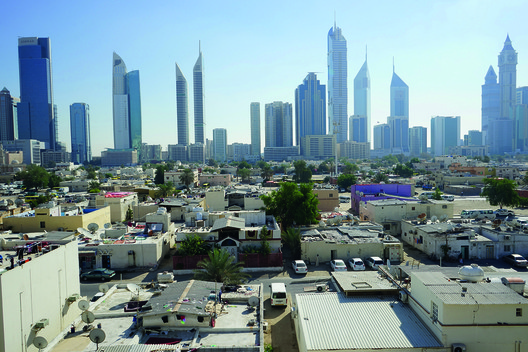 Contrasting Urbanism: Human Scale Landscape in the foreground, and contemporary downtown Dubai in the background. Image Courtesy of National Pavilion UAE - la Biennale di Venezia