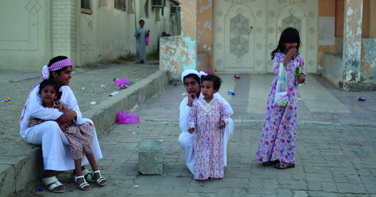 Children playing at their doorstep and in the alleyways of Bani-Yas, a traditionally designed Abu Dhabi neighborhood. Image Courtesy of National Pavilion UAE - la Biennale di Venezia