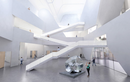 A central atrium gives space for exhibitions. Image Courtesy of Steven Holl
