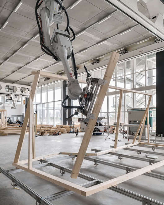 05_Robotic_Collaboration ETH Zurich Uses Robots To Construct Three-Story Timber-Framed House Architecture