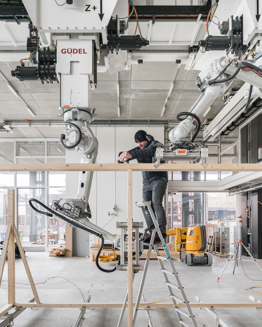 08_Robotic_Collaboration ETH Zurich Uses Robots To Construct Three-Story Timber-Framed House Architecture