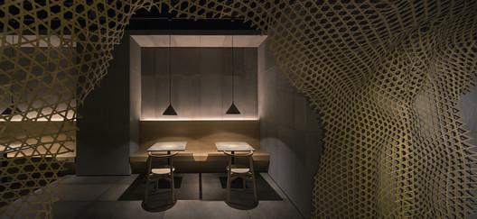 Dim light matches concrete furnishing. Image © Haochang Cao, Songyang Ba
