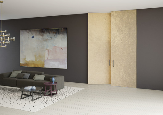 Linvisibile - Brezza Filo 10 Vertical Pivot Door_Alcantara® Finish. Image Courtesy of Linvisibile