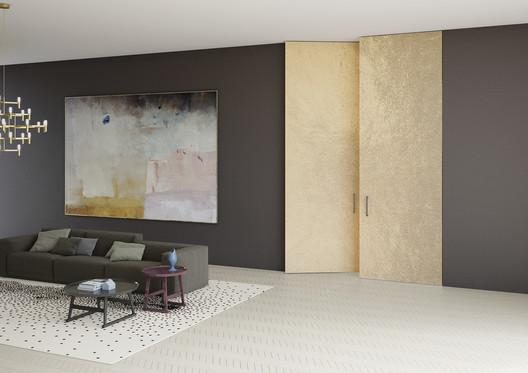Linvisibile - Brezza Filo 10 Vertical Pivot Door_Alcantara® Finish. Image Courtesy of Linvisibile