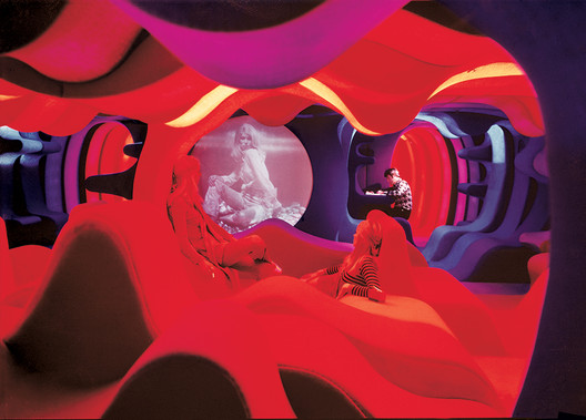 "Verner Panton's ""Visiona2"" exhibition in 1970. The show, which was located in a boat docked on the Rhine, collapsed essential spatial differentiations, such as that between the wall and the floor, to create spaces that would envelop the inhabitant. Image via Metropolis Magazine. Image Courtesy of Panton Design, Basel"