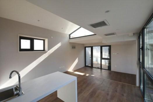 Living room with sunshine. Image © Jun Liu