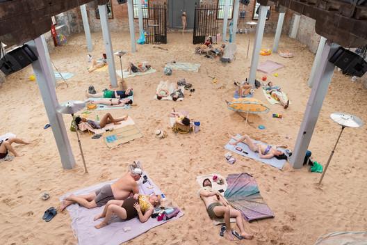 Installation view of Sun & Sea (Marina), at the Lithuanian pavilion at the 58th International Art Exhibition – la Biennale di Venezia, 2019.  © Andrej Vasilenko