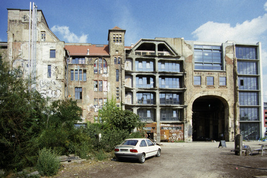 "the center for alternative art ""Kunsthaus Tacheles"" in the Mitte district of Berlin. Image via Shutterstock/ By 360b"