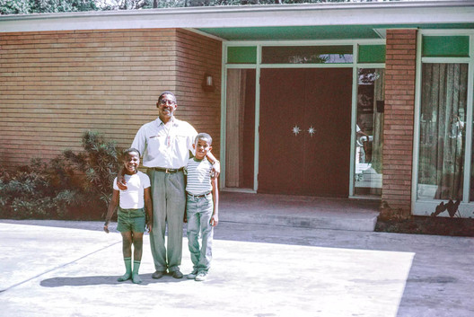 Architect John S. Chase with his sons Anthony (left) and John, Jr. (right). The trio stand in front of the Chase Residence, built in 1959. Image Courtesy of John and Drucie Chase Collection, African American Library at the Gregory School, Houston Public Library