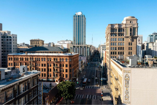 At 35 floors plus a roof deck, Perla on Broadway rises high above the historic core of Downtown Los Angeles. The landmark Bradbury Building and Million Dollar Theatre are pictured in the foreground.. Image © Hunter Kerhart