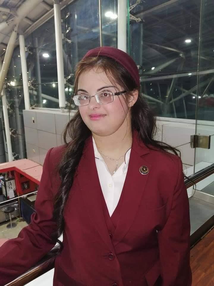 نتيجة بحث الصور عن «هبة» أول مضيفة طيران مصرية من «متلازمة داون»