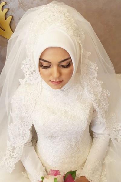 لفات طرح عصرية ومتنوعة للعروس المحجبة دنيا الوطن