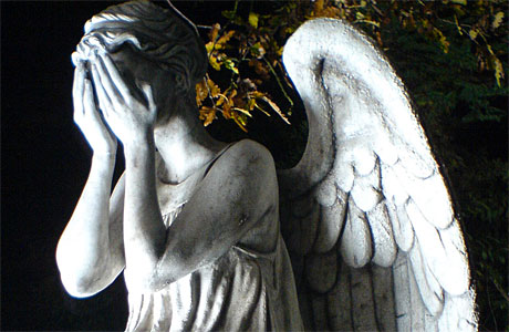 Weeping Angel covering its face