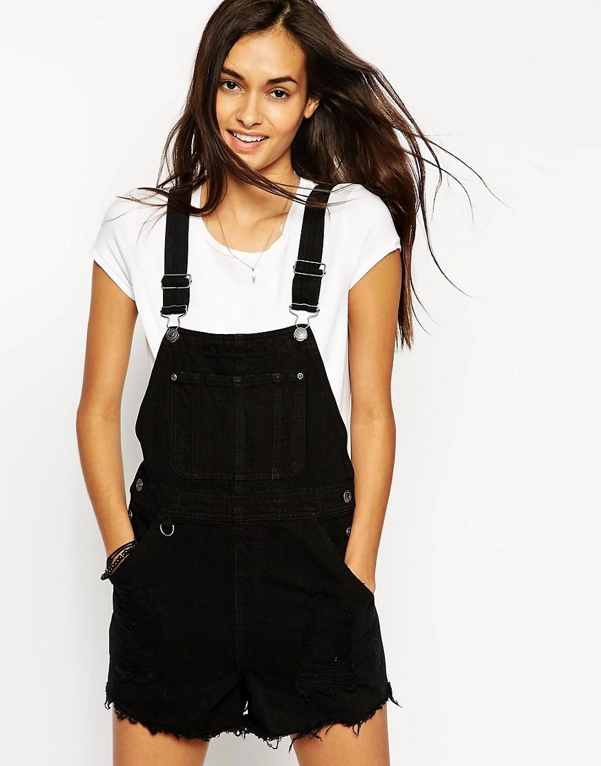 Bild 1 von ASOS – Kurze, ungesäumte Jeans-Latzhose in Schwarz