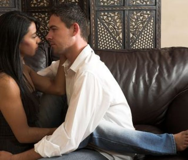 Multi Ethnic Couple In Passionate Embrace And Undressing Each Other During Sexual Foreplay