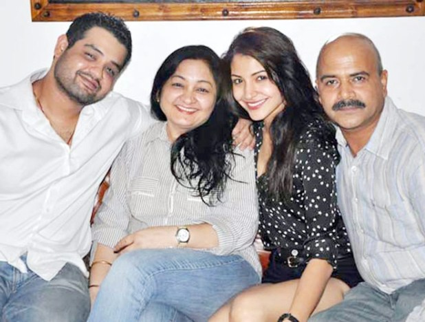 Anushka with her parentsand brother