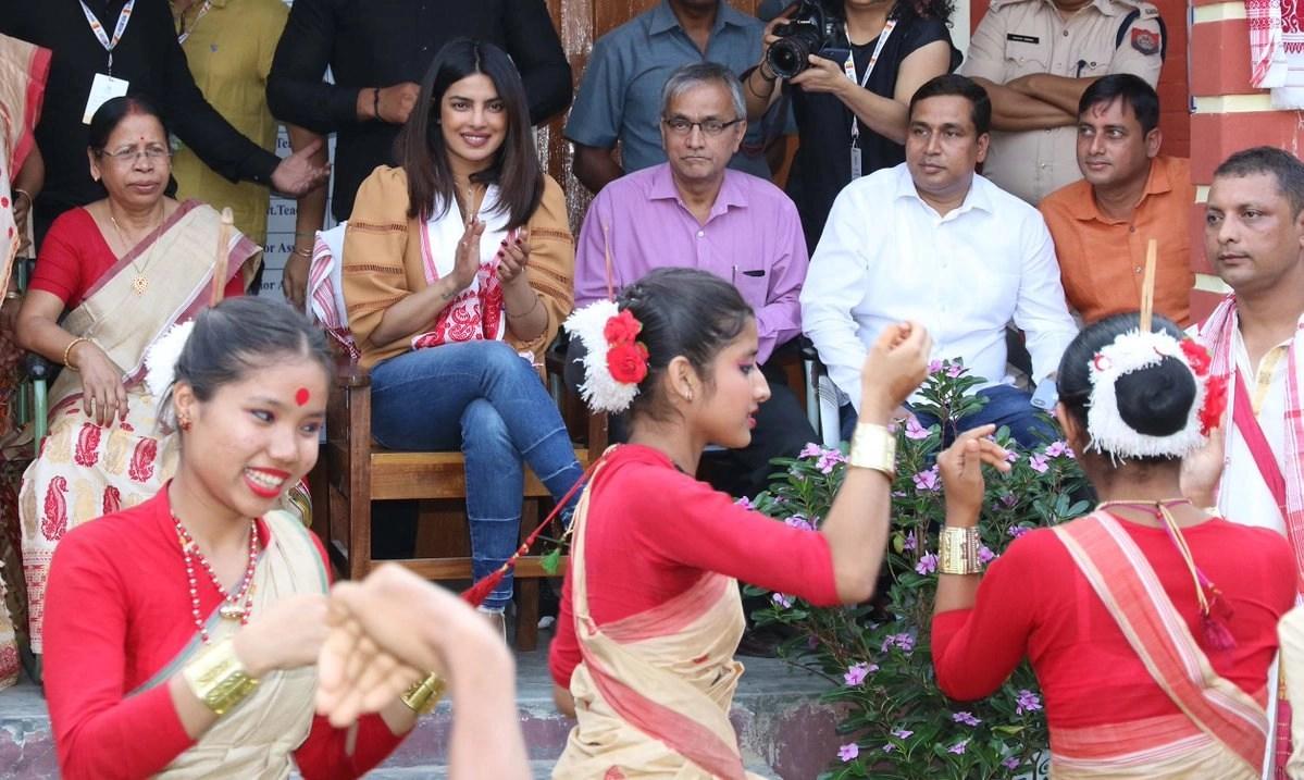 Priyanka enjoys a traditional performance.